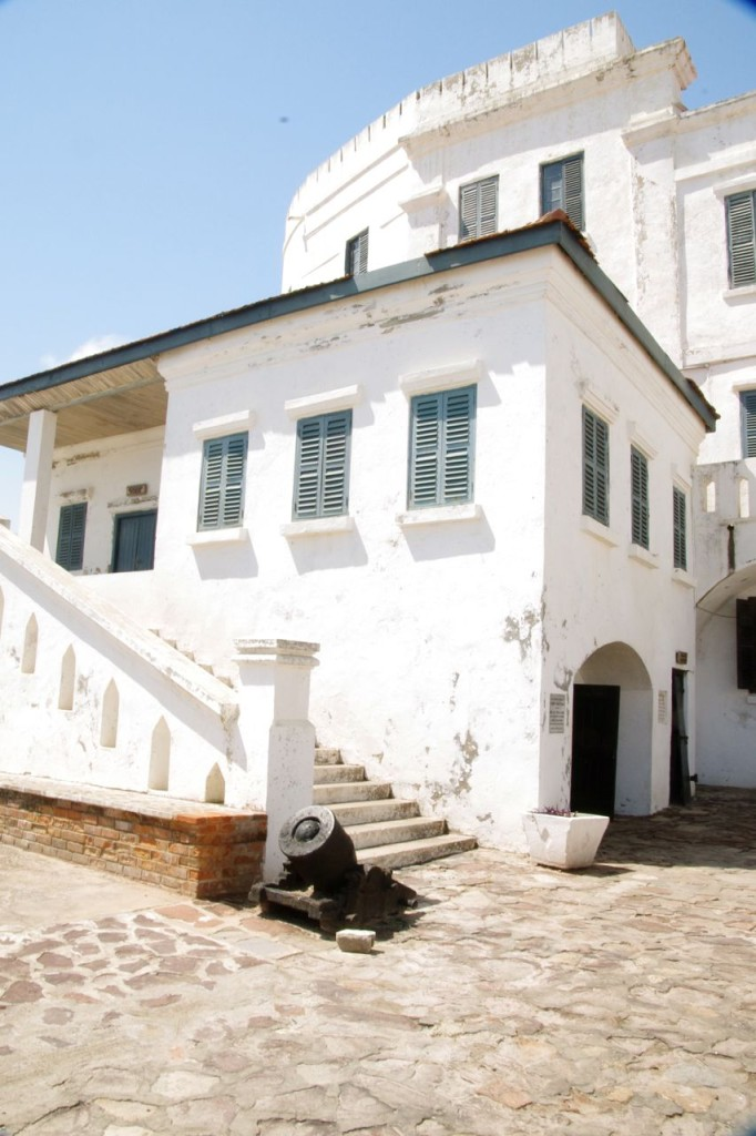 Cape Coast Castle. The archway leads to the male dungeons. The stairs lead to the castle church.
