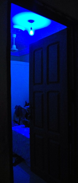 Blue light through a half opened door.
