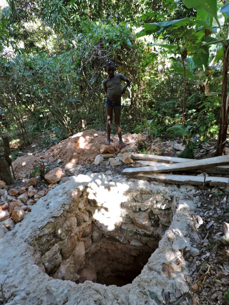Find a hole, a deep hole. This should be easy as the Haitians dig their own latrine holes once they hear you are coming.