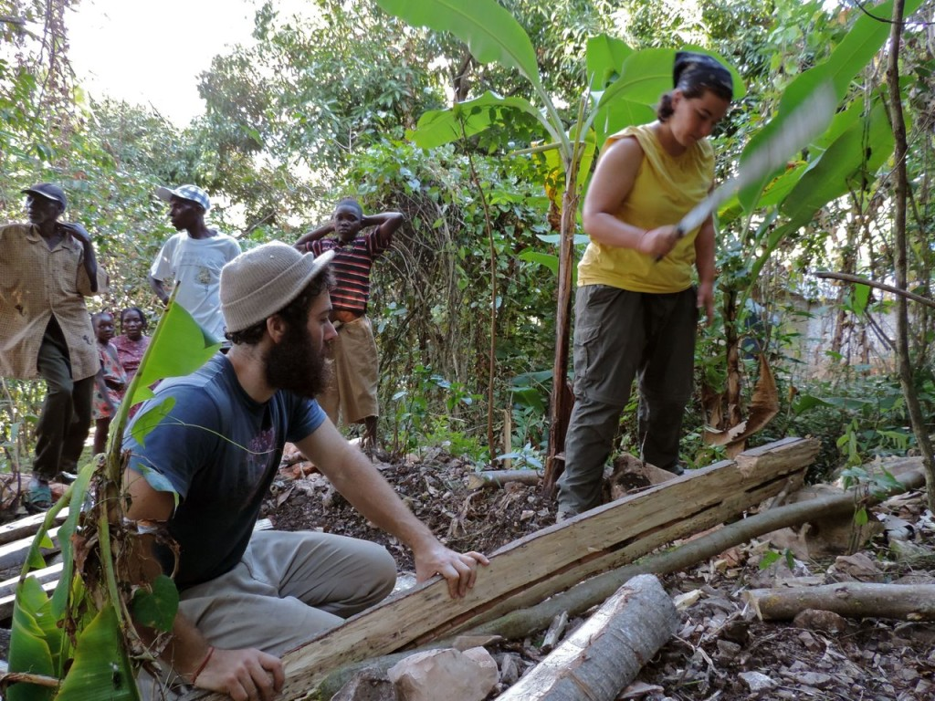 Cut some wood to cover the hole. (That's me wielding a machete--love it!)